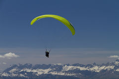 Paraglider over the mountains (green) Stock Image