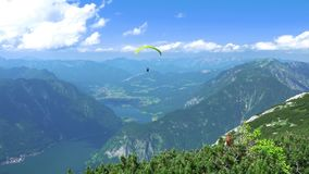Paraglider over Mountains and Lkes. UHD stock video