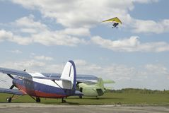 Paraglider over planes Stock Photos