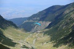 Paraglider over Transfagarasan road stock image