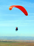 Paraglider over the valley. With village in the distance Royalty Free Stock Photos