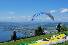 Paraglider over the Zug city, Zugersee and Swiss Alps, Switzerland. Paraglider over the Zug city, Zugersee and Swiss Alps, Zug mountain, Switzerland Stock Photos