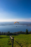 Paraglider over the Zug city, Zugersee and Swiss Alps Royalty Free Stock Images