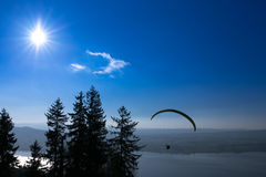 Paraglider over the Zug city, Zugersee and Swiss Alps Royalty Free Stock Photo