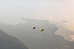 Paraglider. Paragliding over the lake, view from the mountain Stock Photos