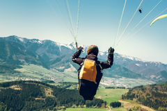 Paraglider is on the paraplane strops - soaring flight moment Stock Photo
