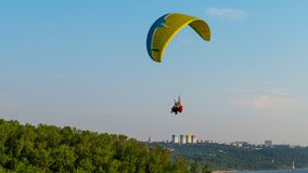 Paraglider with passanger flying in the blue sky. royalty free stock photography