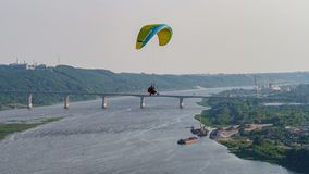 Paraglider with passanger flying in the blue sky. royalty free stock photo