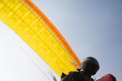 Paraglider pilot flies his wing Royalty Free Stock Photos