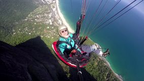 Paraglider pilot, physical handicapped, flying in their own paragliding stock video footage