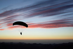 Paraglider pilot on sunset Royalty Free Stock Photography