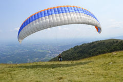 Paraglider pilot take off Stock Photos