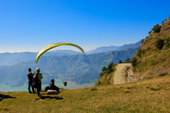 Paraglider preparing to launch itself in the air. Stock Photos