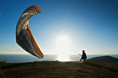 Paraglider Preps to Launch Stock Photography