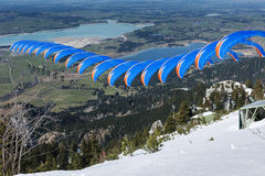 Free Paraglider Sequence Blue Orange In Bavaria Stock Images - 67710964