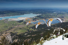 Paraglider sequence gray orange in Bavaria Stock Photos