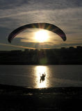 Paraglider silhouette. Sundown stock photography