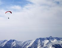 Paraglider silhouette of mountains in sunlight sky. Caucasus Mountains. Georgia, ski resort Gudauri Stock Photography