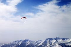 Paraglider silhouette of mountains in windy sky Royalty Free Stock Photos