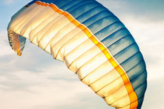 Paraglider on sky. Paraglider wing in air against sky Royalty Free Stock Image