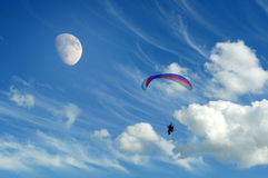 Paraglider in the sky. Paraglider flying in clear blue sky Royalty Free Stock Photo