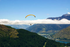 Paraglider in the sky, New Zealand. Paraglider in the sky, Queenstown, New Zealand Royalty Free Stock Images