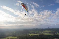 Paraglider in the sky over wasserkuppe mountain in germany Stock Photos