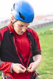 Paraglider or skydiver in red uniform and helmet royalty free stock photography