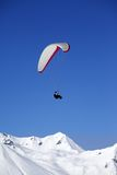 Paraglider in snowy winter mountains Stock Photography