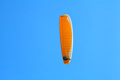 Paraglider in the sky. Paraglider soaring in the blue sky stock photos