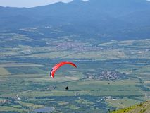 Paraglider at Sopot, Bulgaria. Paraglider flying above Rose Valley, Bulgaria Stock Image
