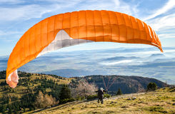 Paraglider is starting  to start his flight. Stock Images