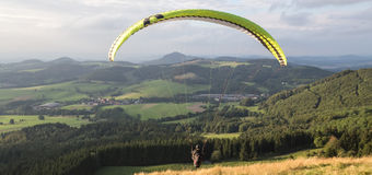 Paraglider starting on the wasserkuppe germany Royalty Free Stock Photos