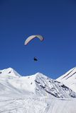 Paraglider in sunny snowy mountains Royalty Free Stock Photos