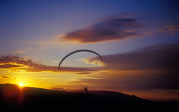 Paraglider at sunset. Stock Photo