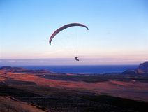 Paraglider at sunset. Royalty Free Stock Photography