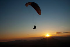 Paraglider in sunset. Over the extinct vulcanoes, Hungary Stock Photo