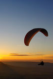 Paraglider in the sunset. Para-glider in Hungary in the sunset Royalty Free Stock Image