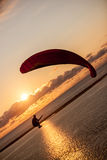 Paraglider at sunset Stock Images