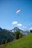 Paraglider in Swiss Alps Stock Photo