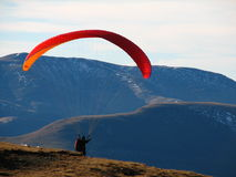 Paraglider take-off. In mountain area Stock Photography