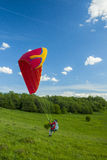 Paraglider on take-off Stock Photo