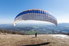 Paraglider take-off Stock Image