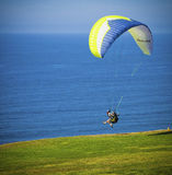 Paraglider Takes Off, La Jolla,   California. A paraglider jumps off a cliff at the Torrey Pines Gliderport in La Jolla, southern California, near San Diego Stock Images
