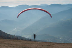 Paraglider takes off Stock Image