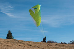 Paraglider takes off Stock Photo