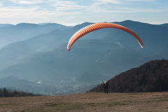 Paraglider takes off from the Treh runway Stock Image