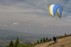 Paraglider taking off Stock Images