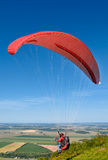 Paraglider taking off Royalty Free Stock Photography
