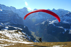 Paraglider taking-off. Paraglider in the Bernese Oberland, Switzerland Stock Image